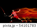 Young man playing badminton isolated on black studio background 54101783