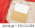 Letter in an envelope on fabric texture. 54111184