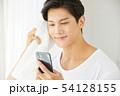 男性 スマホ スマートフォンの写真 54128155