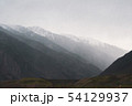 Beautiful view of the silhouettes of the Altai mountain ranges in rainy weather and fog 54129937