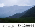 Beautiful view of the silhouettes of the Altai mountain ranges in rainy weather and fog 54129944
