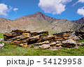 unusual stone formations with colored patches of lichen and moss on the background of mountains and 54129958