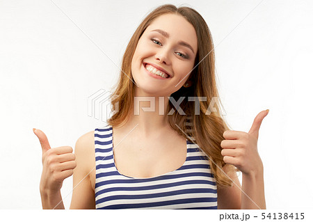 A joyful happy girl shows a sign of thumbs up 54138415
