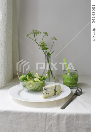 Green fresh breakfast. Healthy raw diet. Detox smoothie bright color. Blue cheese and salad. White 54143001