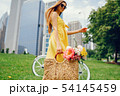 pretty girl with bicycle 54145459
