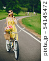 pretty girl with bicycle 54145472