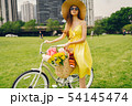 pretty girl with bicycle 54145474