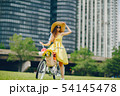 pretty girl with bicycle 54145478