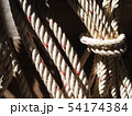 Large white rope hung on the wall. Rope background 54174384