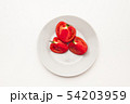 Sliced Fresh ripe tomatoes on a plate 54203959