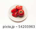 Sliced Fresh ripe tomatoes on a plate 54203963