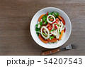 spicy squid ring salad in a ceramic plate. 54207543