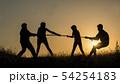 Family having fun in nature - playing tug of war 54254183