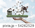 Woman's hand holding ipad with green grass growing on screen and man running from things flying out 54262529
