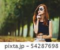 Redhead girl in Versailles park 54287698