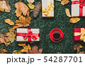 Cup of coffee and autumn yellow leaves with gifts 54287701