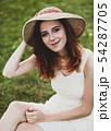 girl at green grass at village outdoor. 54287705