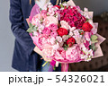 Pink peonies and red hydrangea. Beautiful bouquet of mixed flowers in woman hand. Floral shop 54326021