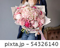 Pink peonies and hydrangea. Beautiful bouquet of mixed flowers in woman hand. Floral shop concept 54326140