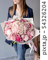 Pink peonies and hydrangea. Beautiful bouquet of mixed flowers in woman hand. Floral shop concept 54326204