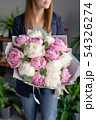 Pink and white peonies in womans hands. Beautiful peony flower for catalog or online store. Floral 54326274