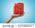 Side closeup of woman's hand facing up and holding red metal jerrican on light blue gradient 54380027