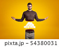 Young man in casual clothes cut in half with white cloud inside on yellow background 54380031