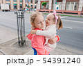 Children walk down the street and smile 54391240