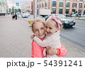 Children walk down the street and smile 54391241