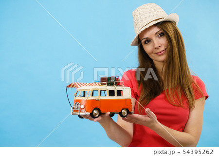 Holiday woman with camper van trailer 54395262