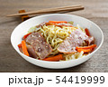 close up of stir fried japanese noodles with bacon 54419999