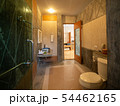 Interior of bathroom with toilet in warm light 54462165