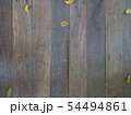 The old slatted floor with dry leaves. 54494861