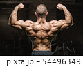 strong athletic men pumping up back muscles 54496349