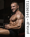 muscular bodybuilder fitness men doing arms 54496351
