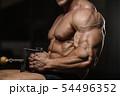 muscular bodybuilder fitness men doing arms 54496352
