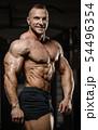 muscular bodybuilder fitness men doing abs 54496354