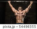 strong athletic men pumping up back muscles 54496355