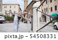 A woman drink water from the water pump in the historic town 54508331