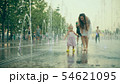 Mom and her little baby having fun while walking in the fountain, slow motion 54621095