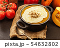 Pumpkin soup with cream and croutons in a pot 54632802