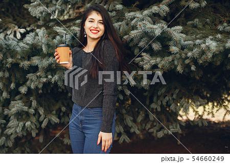 Fashion girl walking in a summer city 54660249