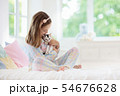 Child playing with baby cat. Kid and kitten. 54676628