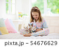 Child playing with baby cat. Kid and kitten. 54676629