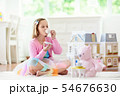 Little girl playing with doll house. Kid with toys 54676630