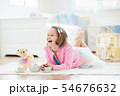 Little girl playing with doll house. Kid with toys 54676632