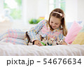 Child playing with baby cat. Kid and kitten. 54676634