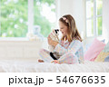 Child playing with baby cat. Kid and kitten. 54676635