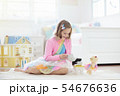 Little girl playing with doll house. Kid with toys 54676636