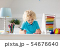 Child with abacus doing homework after school. 54676640